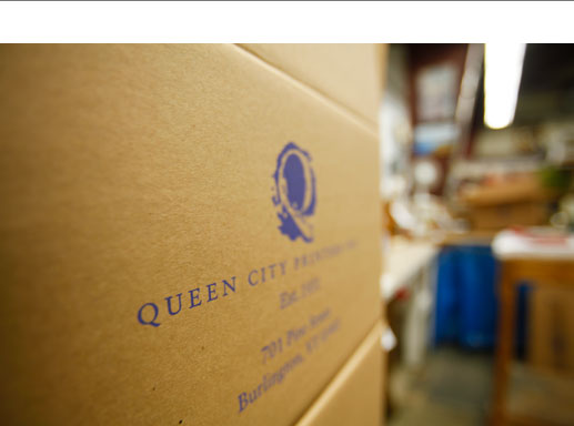 cardboard shipping box with QCP logo