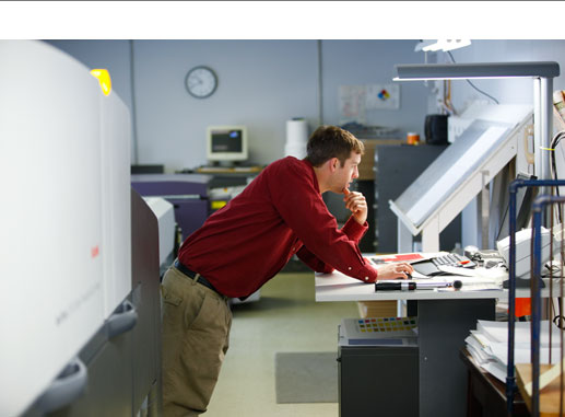 man working prepress on a digital press